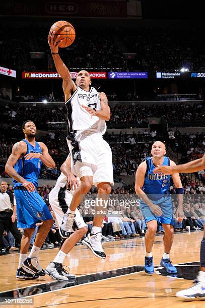 George Hill of the San Antonio Spurs shoots a layup against the Dallas Mavericks during the game on November 26 2010 at the ATT Center in San Antonio...