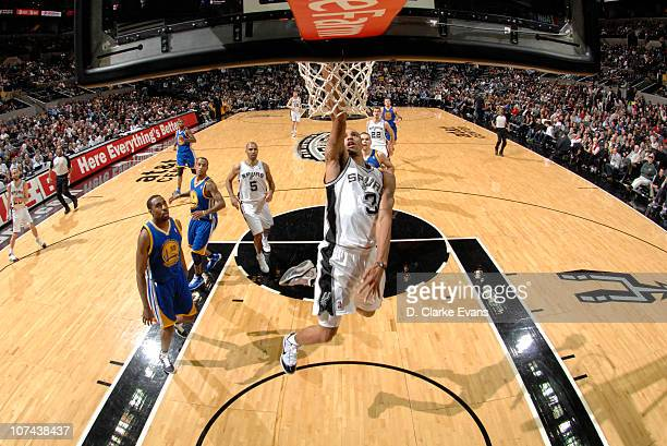 George Hill of the San Antonio Spurs shoots a layup against the Golden State Warriors during the game on December 8 2010 at the ATT Center in San...