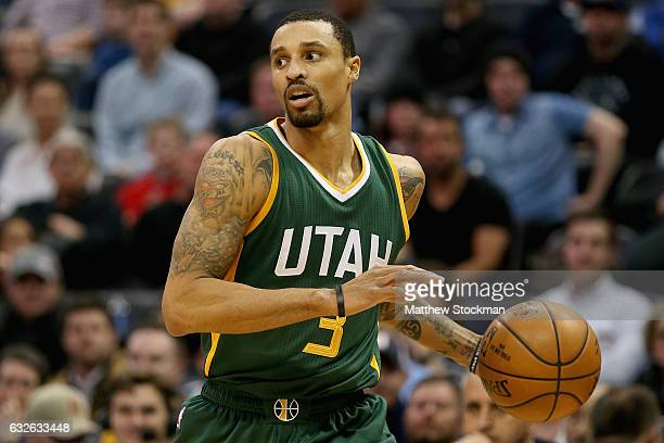 George Hill of the Utah Jazz brings the ball down court against the Denver Nuggets at the Pepsi Center on January 24 2017 in Denver Colorado NOTE TO...