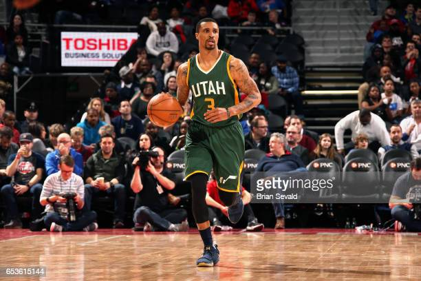 George Hill of the Utah Jazz brings the ball up court during the game against the Detroit Pistons on March 15 2017 at The Palace of Auburn Hills in...