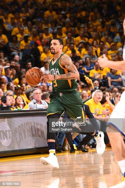 George Hill of the Utah Jazz brings the ball up court during the game against the Golden State Warriors during Game One of the Western Conference...
