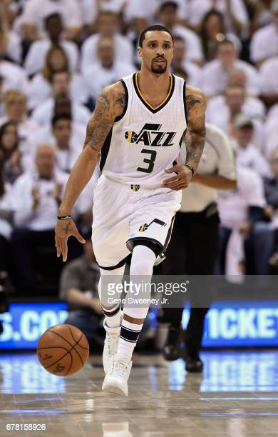 George Hill of the Utah Jazz brings the ball up court in the first half against the Los Angeles Clippers in Game Six of the Western Conference...