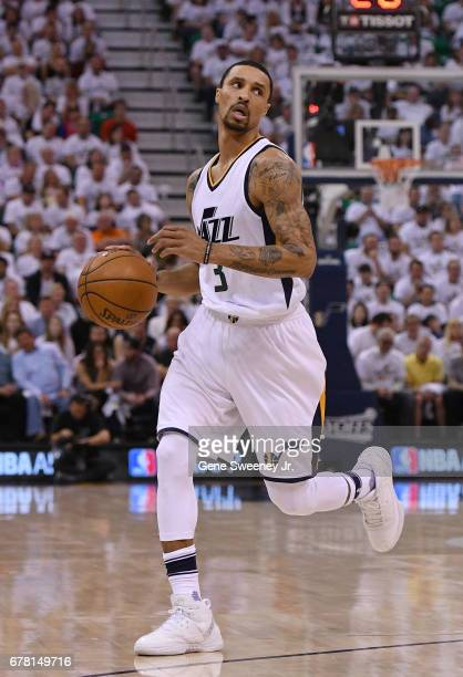 George Hill of the Utah Jazz controls the ball in the first half against the Los Angeles Clippers in Game Four of the Western Conference...