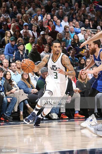 George Hill of the Utah Jazz drives to the basket against the Philadelphia 76ers during the game on December 29 2016 at vivintSmartHome Arena in Salt...