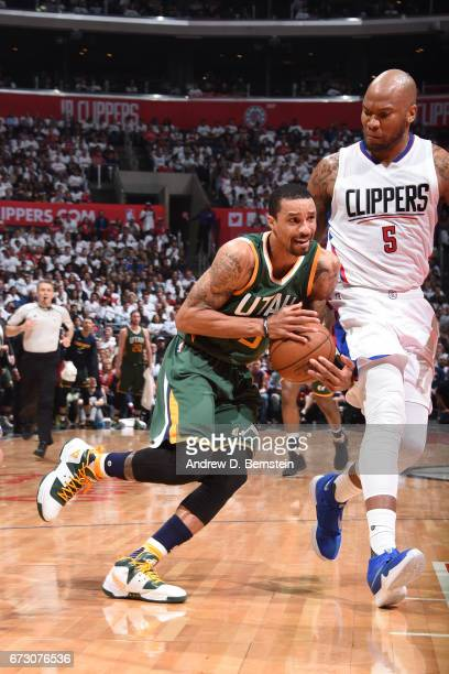 George Hill of the Utah Jazz drives to the basket against the LA Clippers in Game Five of the Western Conference Quarterfinals of the 2017 NBA...