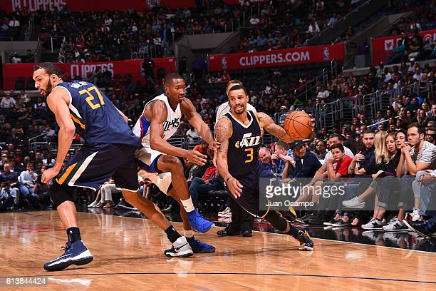 George Hill of the Utah Jazz drives to the basket against the Los Angeles Clippers during a preseason game on October 10 2016 at STAPLES Center in...