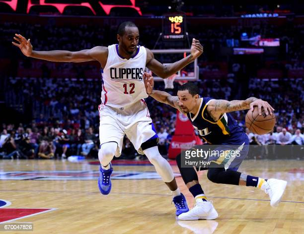 George Hill of the Utah Jazz drives to the basket as he is guarded by Luc Mbah a Moute of the LA Clippers during a 9991 Clippers win in Game Two of...