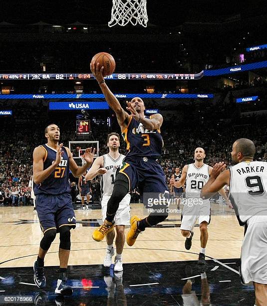 George Hill of the Utah Jazz drives to the basket during game between Utah Jazz and the San Antonio Spurs at ATT Center on November 1 2016 in San...