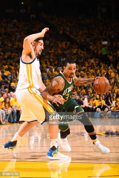 George Hill of the Utah Jazz drives to the basket during the game against the Golden State Warriors during Game One of the Western Conference...