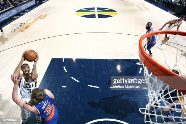 George Hill of the Utah Jazz goes to the basket against the New York Knicks on March 22 2017 at vivintSmartHome Arena in Salt Lake City Utah NOTE TO...