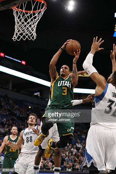 George Hill of the Utah Jazz goes up for a lay up during a game against the Minnesota Timberwolves on November 28 2016 at the Target Center in...
