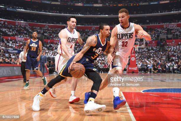 George Hill of the Utah Jazz handles the ball against Blake Griffin of the LA Clippers during Game Two of the Western Conference Quarterfinals of the...