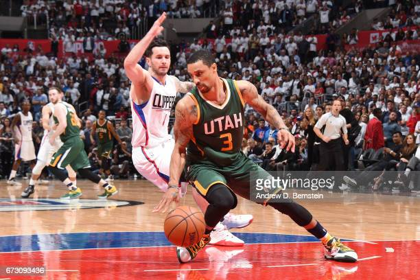 George Hill of the Utah Jazz handles the ball against the LA Clippersin Game Five of the Western Conference Quarterfinals of the 2017 NBA Playoffs on...