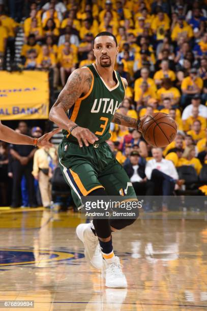 George Hill of the Utah Jazz handles the ball against the Golden State Warriors during Game One of the Western Conference Semifinals of the 2017 NBA...