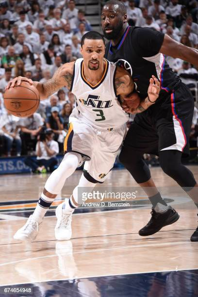 George Hill of the Utah Jazz handles the ball against the Los Angeles Clippers during Game Six of the Western Conference Quarterfinals of the 2017...