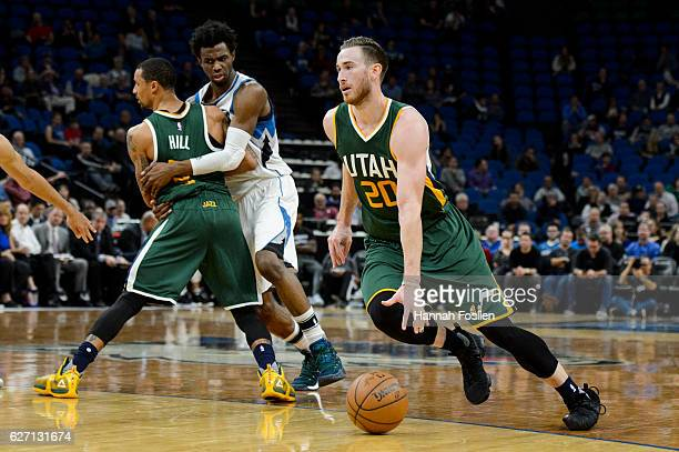 George Hill of the Utah Jazz sets a pick for Andrew Wiggins of the Minnesota Timberwolves as teammate Gordon Hayward dribbles past during the game on...
