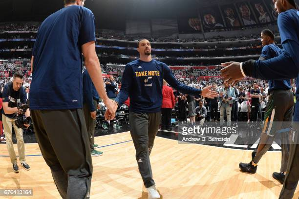 George Hill of the Utah Jazz shakes hands with teammates before Game Seven of the Western Conference Quarterfinals against the LA Clippers during the...