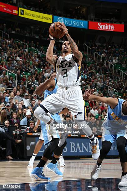 George Hill of the Utah Jazz shoots the ball against the Denver Nuggets on November 23 2016 at vivintSmartHome Arena in Salt Lake City Utah NOTE TO...