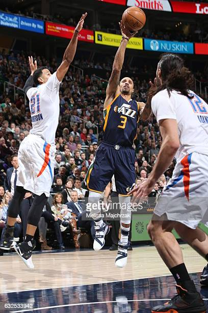 George Hill of the Utah Jazz shoots the ball against the Oklahoma City Thunder on January 23 2017 at vivintSmartHome Arena in Salt Lake City Utah...