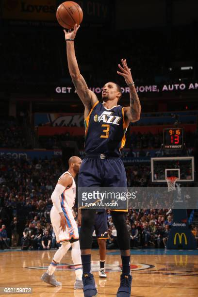 George Hill of the Utah Jazz shoots the ball during a game against the Oklahoma City Thunder on March 11 2017 at Chesapeake Energy Arena in Oklahoma...
