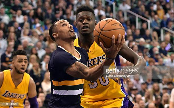 George Hill of the Utah Jazz tries for a basket past the defense of Julius Randle of the Los Angeles Lakers in the second half of the 9689 win by the...