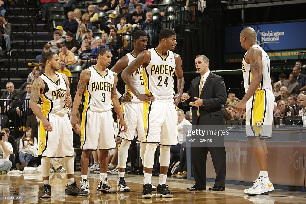 George Hill #3, Paul George #24 and <a gi-track='captionPersonalityLinkClicked' href=/galleries/search?phrase=D.J.+Augustin&family=editorial&specificpeople=3847521 ng-click='$event.stopPropagation()'>D.J. Augustin</a> #14 of the Indiana Pacers speak with the coach on November 21, 2012 at Bankers Life Fieldhouse in Indianapolis, Indiana.