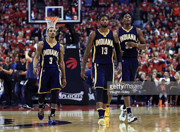 George Hill Paul George and Myles Turner of the Indiana Pacers walk to the bench during a break in the first half of Game Seven of the Eastern...