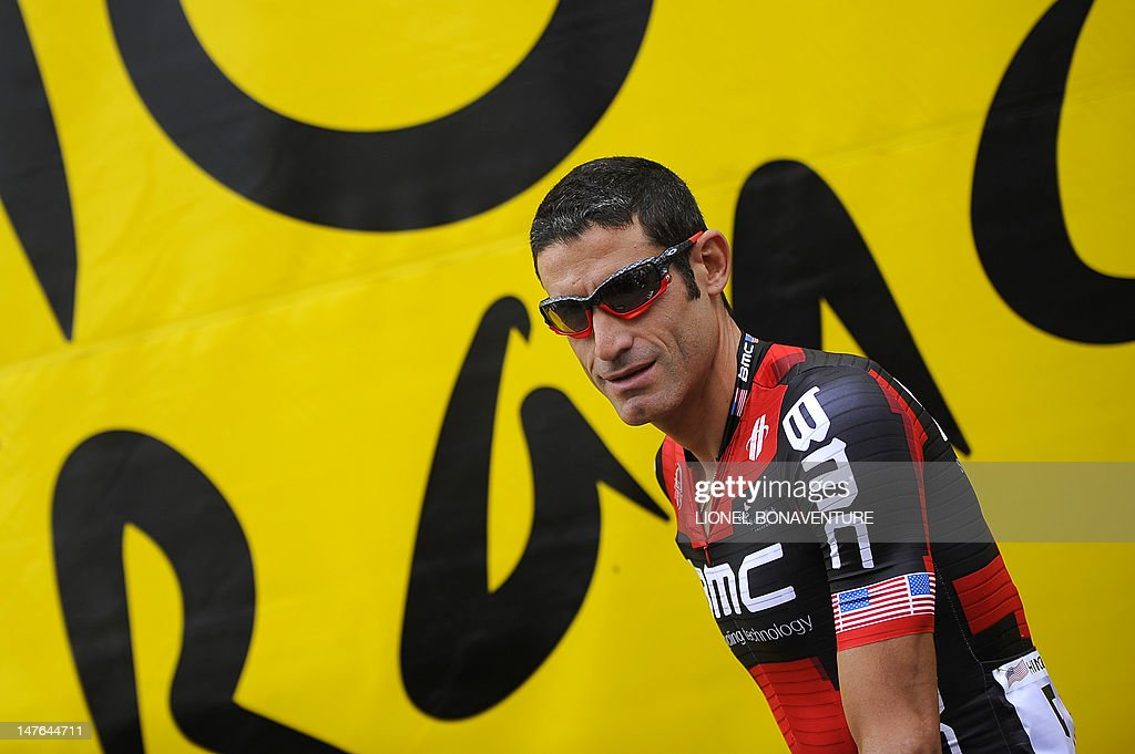 US George Hincapie attends the signature ceremony prior to the beginning of the 207,5 km and second stage of the 2012 Tour de France cycling race starting in Vise and finishing in Tournai, on July 2, 2012. The 99th Tour de France, to be held from June 30 till July 22, will be made up of one prologue and 20 stages and will cover a total distance of 3.497 kilometres.