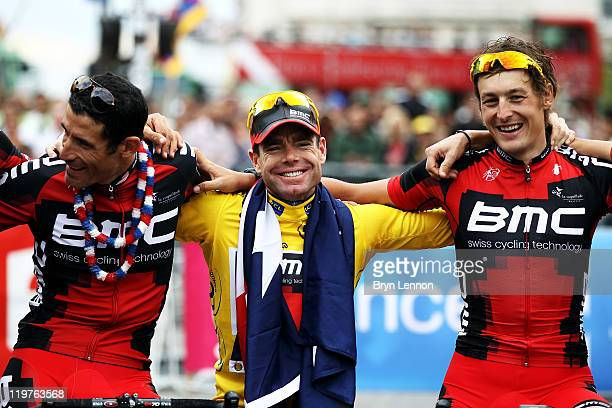George Hincapie Cadel Evans and Marcus Burghardt of team BMC signs take part in a victory parade after winning the 2011 Tour de France after the...