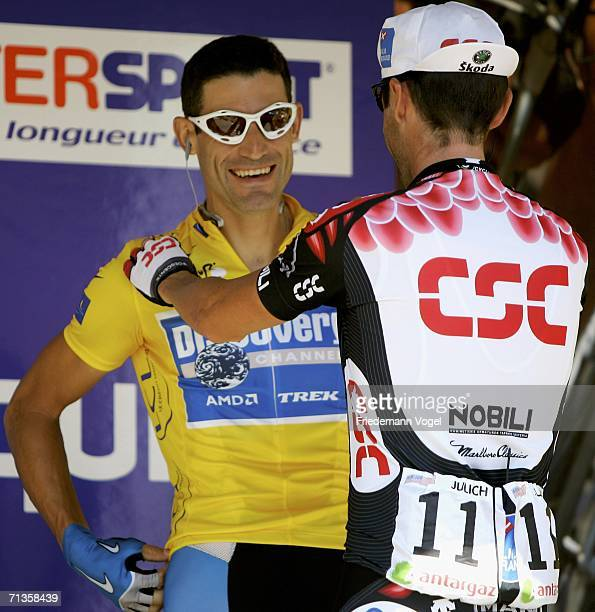 George Hincapie of the USA and Discovery Team speaks to Bobby Julich of the USA and CSC team before Stage 2 of the 93rd Tour de France between...