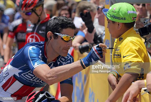 George Hincapie of the USA and riding for BMC Racing signs a jersey for a young fan before the start of Stage Eight of the 2010 Tour of California on...