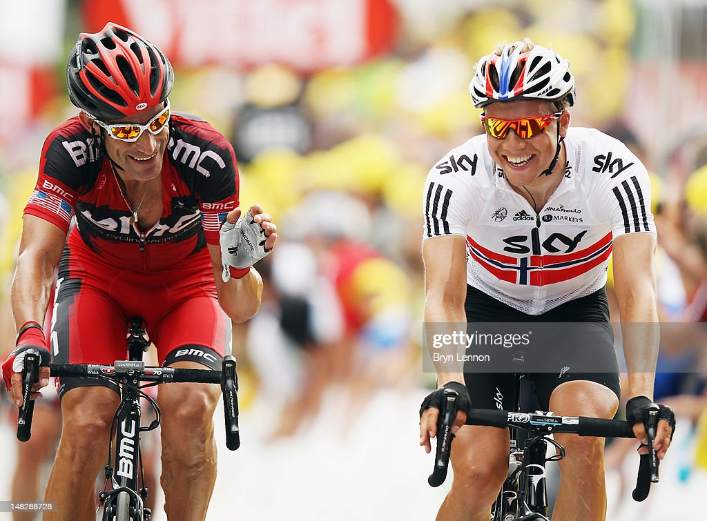 George Hincapie (l) of the USA and the BMC Racing Team chats to Edvald Boasson Hagen of Norway and SKY Procycling as they cross the finish line on stage twelve of the 2012 Tour de France from Saint-Jean de Maurienne to Annonay Davezieux on July 13, 2012 in Annonay, France.