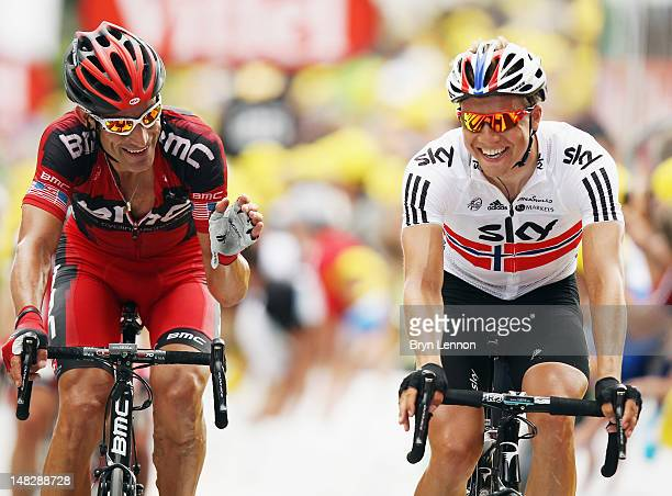George Hincapie of the USA and the BMC Racing Team chats to Edvald Boasson Hagen of Norway and SKY Procycling as they cross the finish line on stage...