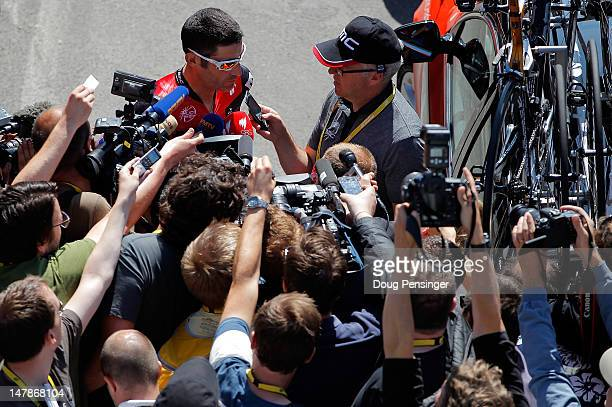 George Hincapie of the USA riding for BMC Racing addresses members of the media prior to the start of stage five of the 2012 Tour de France from...