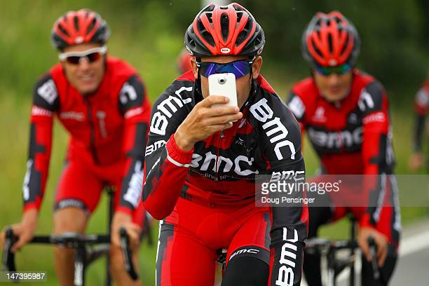 George Hincapie of the USA riding for BMC Racing photographs the photographers during a training ride in preparation for the 2012 Tour de France on...