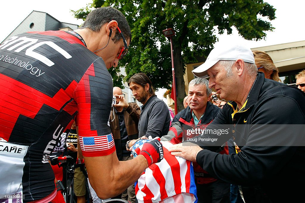 George Hincapie of the USA riding for BMC Racing signs an autograph for a fan as he heads to the start of stage two of the 2012 Tour de France from Vise to Tournai on July 2, 2012 in Vise, Belgium.