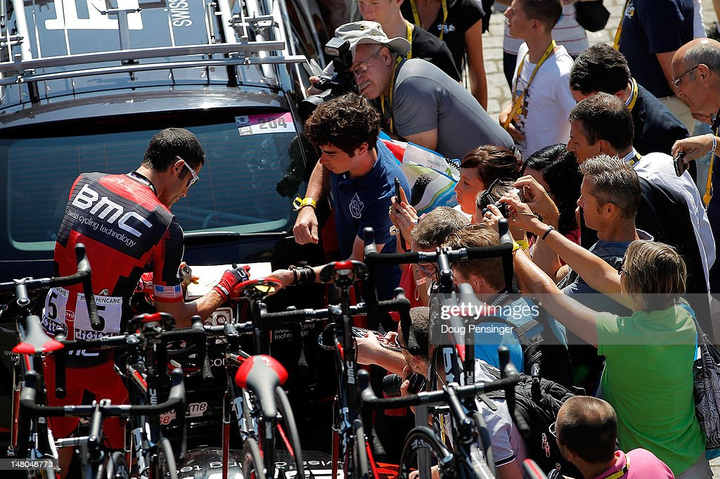 George Hincapie of the USA riding for BMC Racing signs autographs for fans at the begining of stage five of the 2012 Tour de France from Rouen to Saint-Quentin on July 5, 2012 in Rouen, France.