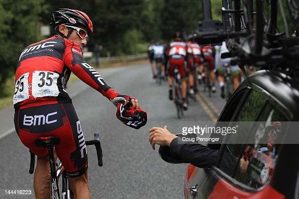 George Hincapie riding for BMC Racing deposits clothing in the team car during stage one of the Amgen Tour of California on May 13 2012 in Santa Rosa...