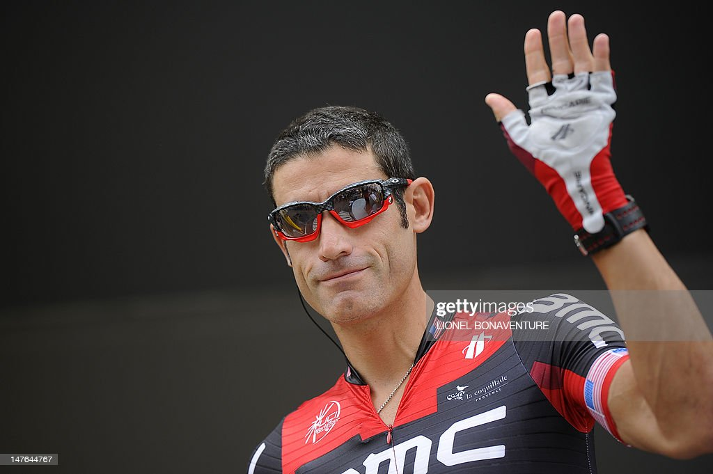 US George Hincapie waves to the public at the signature ceremony prior to the beginning of the 207,5 km and second stage of the 2012 Tour de France cycling race starting in Vise and finishing in Tournai, on July 2, 2012. The 99th Tour de France, to be held from June 30 till July 22, will be made up of one prologue and 20 stages and will cover a total distance of 3.497 kilometres.