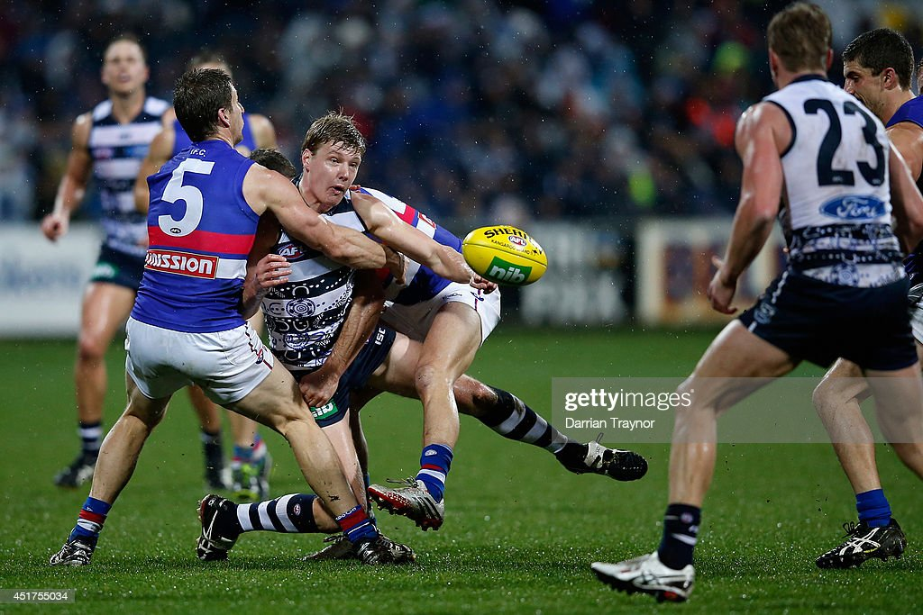 George Horlin-Smith of the Cats is tackled during the round 16 AFL match between the Geelong Cats and the Western Bulldogs at Skilled Stadium on July 6, 2014 in Melbourne, Australia.