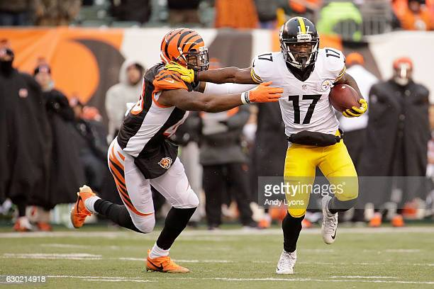 George Iloka of the Cincinnati Bengals attempts to tackle Eli Rogers of the Pittsburgh Steelers during the fourth quarter at Paul Brown Stadium on...