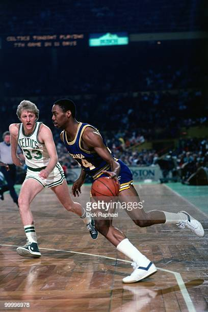 George Johnson of the Indiana Pacers drives against Larry Bird of the Boston Celtics during a game played in 1983 at the Boston Garden in Boston...