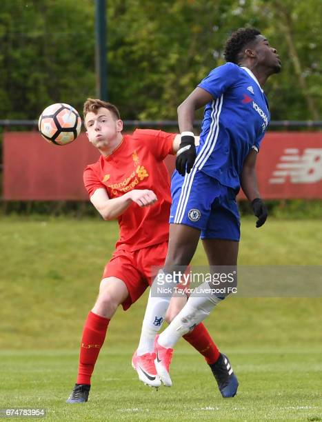 George Johnston of Liverpool and Ike Ugbo of Chelsea in action during the Liverpool v Chelsea U18 Premier League game at The Kirkby Academy on April...
