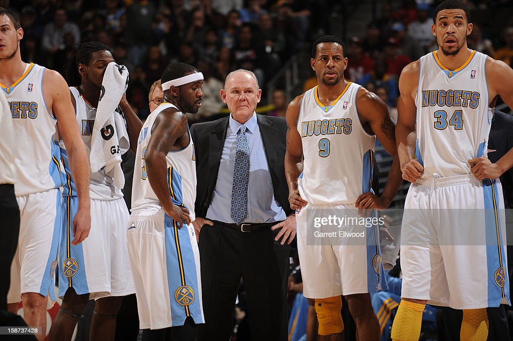 George Karl Head Coach of the Denver Nuggets and his team look on during a time out against the Los Angeles Lakers on December 26, 2012 at the Pepsi Center in Denver, Colorado.