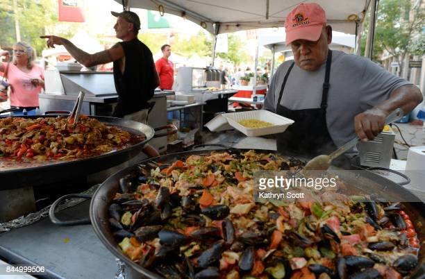 George Kasselakis serves the Pescatorre Platter filled with muscles crab shrimp and salmon Crowds gather for the 14th annual Festival Italiano at...