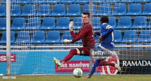 George Kelbel of Goslar scores his team's third goal against goalkeeper Michael Zetterer of Bremen during the Regionalliga Nord match between...