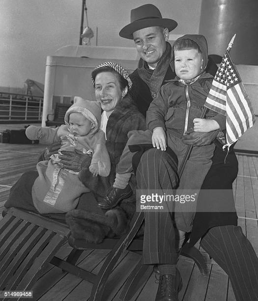 George Kennan ambassador to Moscow his wife and children Wendy 6 months and Christopher holding American flag arrive in New York aboard the liner...