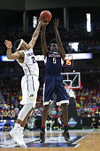 George King of the Colorado Buffaloes defends Daniel Hamilton of the Connecticut Huskies in the first half during the first round of the 2016 NCAA...