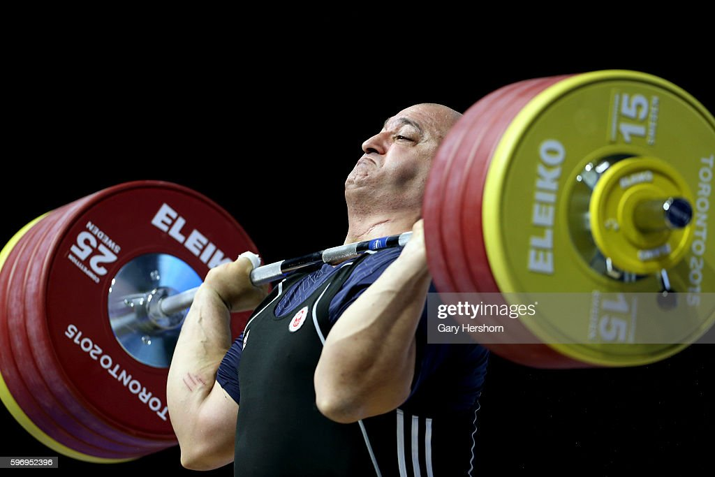 George Kobaladze of Canada successfully lifts 208kg in the clean and jerk competiton of the 105kg group in weightlifting at the Toronto 2015 PanAm...