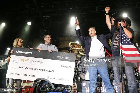 George Kollitides CEO of Remington and NRA Executive Vice President and CEO Wayne LaPierre present a check to Jen Brown of The Lone Survivor...